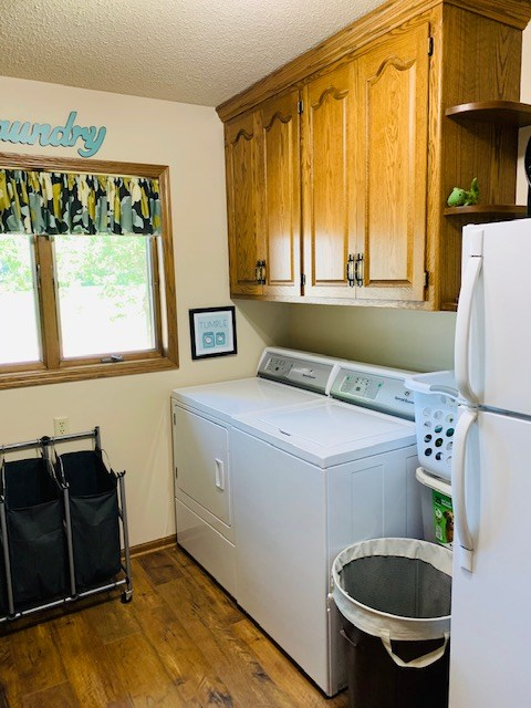 laundry area with lots of storage space